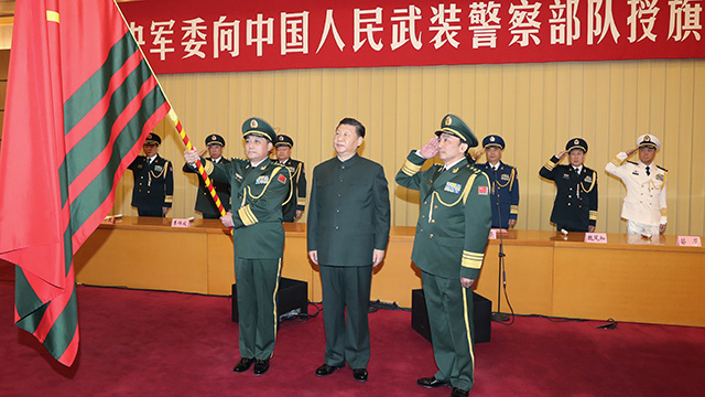 President Xi confers military flag on Armed Police Force