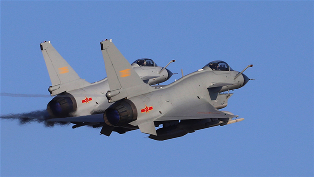 J-10 fighter jets take off under guidance