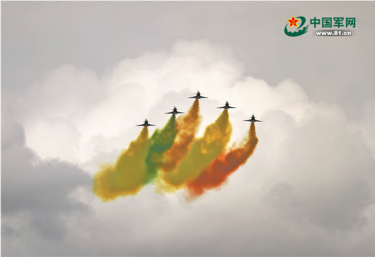 The PLA Air Force's Bayi Aerobatics Team is performing an aerobatic stunt at the opening ceremony of the Singapore Airshow.